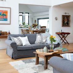 An Open Plan Layout And Bright White Walls Give This Space A Light Airy