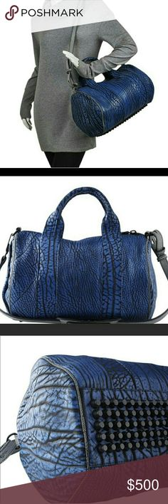 💙 Alexander Wang Blue Nile Rocco 💙 Rare Alexander Wang Rocco - Like New & 💯Authentic   The richly grained blue/black contrast tip nile leather details its lines beautifully...a deeply textured leather effect.  The leather is accented with textured black and white polka-dot leather piping and strap additions.  Retail - $1100  ❌ *❌ *❌ NO TRADES❌* ❌* ❌ Alexander Wang Bags