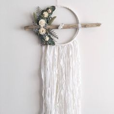 White, cream and green dreamcatcher created with all natural dried flowers and greenery and adorned with the softest silk chiffon. Weathered driftwood and raw quartz complete this romantic piece. 8 inches wide (12 with stick and florals), 35 inches long Made to order. Driftwood and