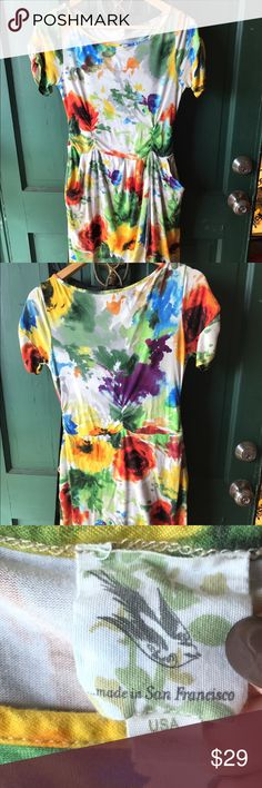 Colorful knee length dress w pockets! Cute fit! Floral print dress, very soft and comfy! Pockets are super cute and bottom half is similar to a wrap dress. Perfect for Spring! Brand unknown, looks like a boutique dress from San Fran. Dresses