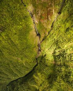 Photo by @jonathankingston Plummeting over 3,500 feet from the lush rainforest of the Kamakou Preserve down to the Pacific ocean, the waterfalls on the north shore of the island of Molokai, Hawaii are a wonder to behold.  @natgeocreative