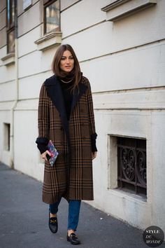 Giorgia Tordini wearing Etro coat, Equipment turtleneck, Saint Laurent jeans and…