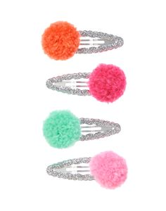 Add shimmery style to her hair. Our glittery scallop snap clips feature colorful pom poms. WARNING: CHOKING HAZARD - Small parts. Not for children under 3 yrs.