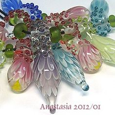 Amazing lampwork artist - and her beads.  : )