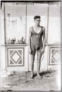 Shorpy Historical Photo Archive :: Johnny Weissmuller in an Illinois Athletic Club swimsuit circa 1922, prior to winning five Olympic gold medals in 1924 and 1928. Before becoming Tarzan and signing a movie contract with MGM in 1932, Weissmuller was a spoke grandpa :)smodel for BVD swimwear. George Grantham Bain Collection.