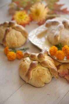 Pan De Muerto - Bread of the Dead. A traditional dish for Dia de los Muertos (Day of the Dead - celebrating the lives of those who have passed away. Nov. 2) Dough and strips on top represent bones and skull. Made with an orange extract and orange glaze. Eaten or left at gravesite or on altar.