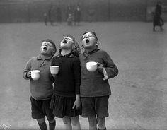 Robert Doisneau, Catching the Rain Robert Doisneau, Black White Photos, Black And White Photography, Singing In The Rain, Kids Singing, Kids Playing, Photocollage, Vintage Photographs, Belle Photo