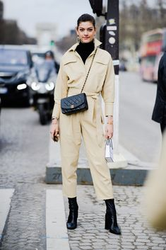 Paris Fashion Week Street Style Fall 2018 | yellow jumpsuit and black leather accessories