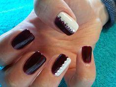 Pretty oxblood and white nail art