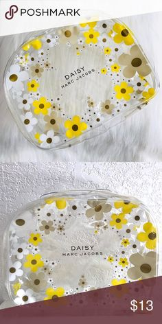 Marc Jacobs Daisy Clear Cosmetic Tote Clear plastic tote with yellow, white & tan daisy design. Gently used, still in good condition. Marc Jacobs Bags Cosmetic Bags & Cases