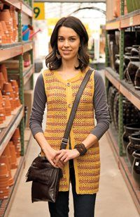 I would make this long crochet vest in a different color, but I'm in love.