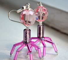Pink T4 Bacteriophage Earrings. A pair of gorgeous pink bacteriophages to show off at the lab or for a stroll in the park! Made with gorgeous faceted pink Swarovski crystals. By Tout Doucement.
