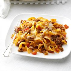 Fiesta Beef & Noodle Skillet Recipe -Tacos and pasta come together in this zesty dish my family demands. It's cheesy, a tad spicy, and you can ring that dinner bell in no time. Meat Recipes, Mexican Food Recipes, Cooking Recipes, Ethnic Recipes, Noodle Recipes, Mexican Dishes, Dinner Recipes, Dinner Ideas