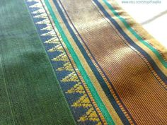 This Amazing Green Ilkal Saree Is A Unique Indian Cotton Fabric. Its Lovely Border Is In Black, Gold & Green Metallic Thread Stripes & Triangular Spikes