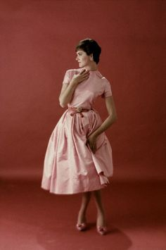 ~November 1957,  Model is wearing a satin dress with belt by Jr. Sophisticates and jewelry by Schreiner.   Image by © Condé Nast Archive/Corbis~