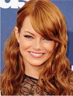 Emma Stone's Tousled Curls with Side Swept bangs