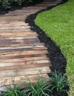 Pallet wood pathway... I like the staggered edge with a thin mulch border to make edging the grass easy. Use a weather-proof stain on the wood. www.ContainerWaterGardens.net