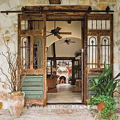 I was going to put this on my 'Portals' board because the focus of this pic is the double sliding doors you see that were upcycled from salvaged pieces of other stuff .... But I'd also love to live in this place .... So it found its way here instead.