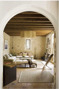 In this Spanish house, the owner has kept the old stone walls  bringing modern equipment.