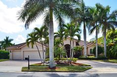 Boca Falls The Estates. Beautiful Warwick Model 5 bd., plus den. Granite Counters, Wood Cabinets in Kitchen. Spectacular Built in Bar, perfect for entertaining. Screened in Oversized Pool and Patio with Expansive Side Yard! Lushly Landscaped, private. Circular Driveway. Move Right In!