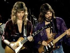Heart guitarists Howard Leese with a Les Paul and Roger Fisher with a Stratocaster.