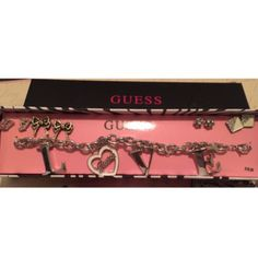 Guess set ! It's super cute ! a charm bracelet and 4 pair of earrings  PLEASENO TRADE OR PAYPAL I will not respond to comment offers . Thank you  Guess Jewelry