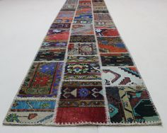 • VİNTAGE PATCHWORK RUGS ;  Our beautiful distressed/recycled patchwork rugs are first deep-washed and then sheared low for an overall antique effect with softened contours of the original patterns. They are then over-dyed in solid colors with color-fast textile dyes safe for health and cut into rectangles. These rectangular carpet pieces are then hand-stitched (not machine-stitched as you generally would find in many other rugs made in the same fashion) to each other and sewn (not glue...
