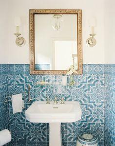 Details. Portuguese tiles, gold mirror, silver sconces.