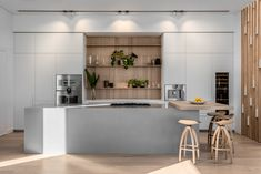 This Cesar Italian kitchen combines natural timber, sleek white cupboards and a solid concrete island. Home, Timber Kitchen, House Design, Timber Staircase, Interior, Modern Light Fittings, White Cupboards, Italian Kitchen, Modern