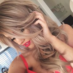 gorgeous light brown hair with subtle blonde highlights. Love this color !!