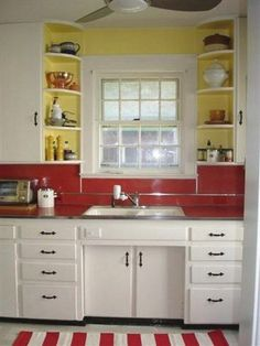 """NOTICE toe kick recess in front of sink- this seems like a practical idea that could prevent weird posture"" ""Colors are ugly though""  Vintage Kitchen"
