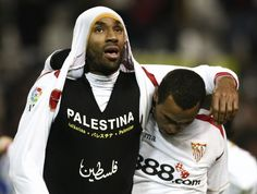 Sevilla striker Frederic Kanoute revealing a T-shirt expressing support for Palestine during a match.
