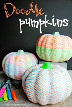 Doodle Pumpkins: an easy and fun Fall decoration. Made with Neon Sharpies And they glow under black light! #NeonSharpie