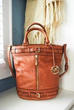 Michael Kors Brown Leather Handbag.   For my birthday please :)