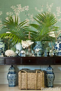 Blue and white porcelain is juxtaposed with white coral to stunning effect in the dining room.