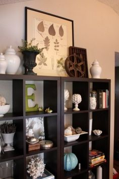 Dark shelves with white, blue, brown accessories. I would add orange and red too!
