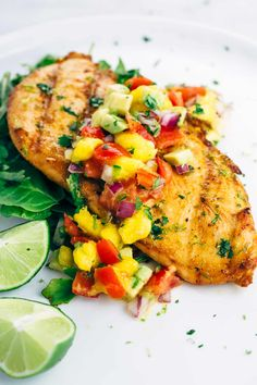 Tequila Lime Chicken with Mango Salsa Debbie Butler Grilled Grilled Tequila Lime Chicken with Mango Salsa - the ultimate quick and easy recipe for warm summer nights. Each honey lime glazed chicken is topped with fresh mango salsa. Tequila Lime Chicken Recipe, Mango Salsa Chicken, Lime Chicken Recipes, Honey Lime Chicken, Glazed Chicken, Mango Salsa Recipes, Recipes With Mango, Margarita Recipes, Grilled Chicken Recipes