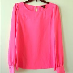 Blogger Favorite! J. Crew Hot Pink Blouse A favorite of so many bloggers! Hot pink J. Crew long sleeve blouse, size S. Excellent condition. Worn only once. Buttons on sleeve and at back of neck. ⛔️ Sorry, no trades.  Price will only be discussed through offer feature. As always thank you for looking! J. Crew Tops Blouses