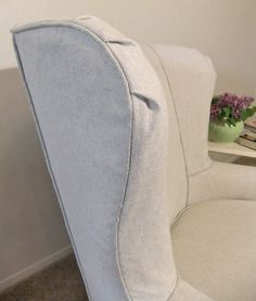 Cotton and linen basketweave slipcover with soft pleats on the wing.