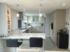 B&Q kitchen and tiles with Neff appliances.