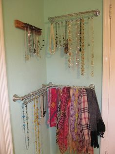 Hang necklaces and scarfs on towel racks using shower curtain rings and hooks