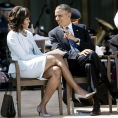 First Lady Michelle Obama and President Barack Obama talk during a dedication ceremony at the George W. Bush Library and Museum on the grounds of Southern Methodist University in Dallas, Texas.