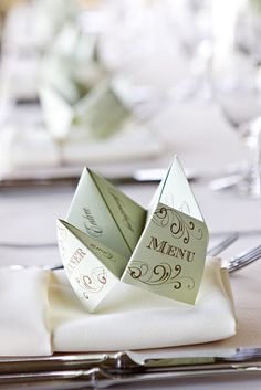 Cootie Catcher Menus - very cute 60's type of item...we played with cootie catchers when we were kids...what a clever way to have a menu for each guest.