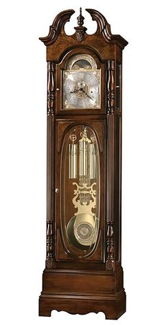 Howard Miller Robinson 611-042 Grandfather Clock  This 79th anniversary traditional cherry floor clock offers bookmatched olive ash burl on the pediment with a shell overlay at the center. Separate doors for the dial and the lower access. Victorian lower door.   An astrological, blue moon phase accents the polished brass dial .  Finished in Cherry Bordeaux.  Cable-driven, triple chime German Kieninger movement with night-time silence option.  Size: H.86 1/4 W.23 D.13 1/2 in.