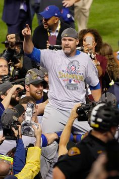 David Ross #3 of the Chicago Cubs celebrates after defeating the Cleveland Indians 8-7 in Game Seven of the 2016 World Series at Progressive Field on November 2, 2016 in Cleveland, Ohio. The Cubs win their first World Series in 108 years.