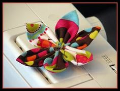 I love these flowers as a bow for the girls' hair or as a clip on one of my jackets.  I would give a shout out to my sister in law in Colora...