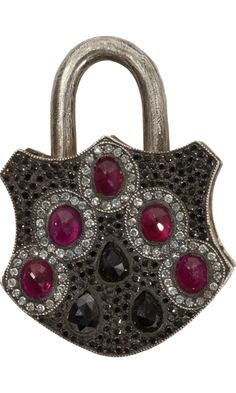 SEVAN BICAKCI Ruby & Black & White Diamond Large Padlock, Oxidized Sterling Silver and 24k Yellow Gold coined edge, large padlock  set with 1.69ct. Black and White Pave and Rose cut Diamonds and 1.67ct. Faceted, Ovular Rubies. Intricate floral etching at back set with White Pave Diamond detail.  12,990 USD