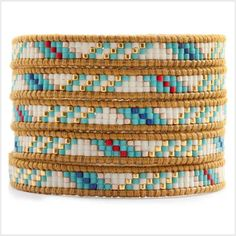 This Chan Luu wrap bracelet features a tribal inspired arrangement of