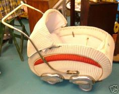.Red and white wicker pram, c 1940. This thing is seriously cool!