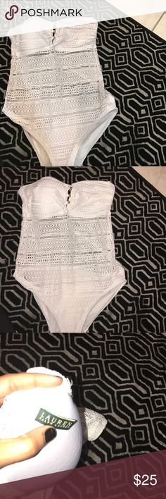 One piece bathing suit. Ralph Lauren. As shown. No straps. Stretches. As shown. Brand new. Fits cup size D/DD/DDD Swim One Pieces